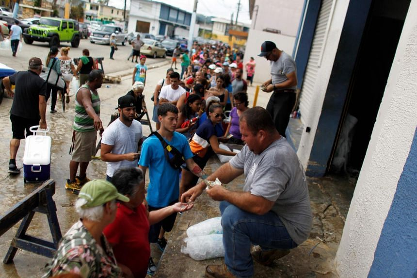 People lining up to buy ice in the aftermath of Hurricane Maria, in Arecibo, Puerto Rico, on Sept 30, 2017.