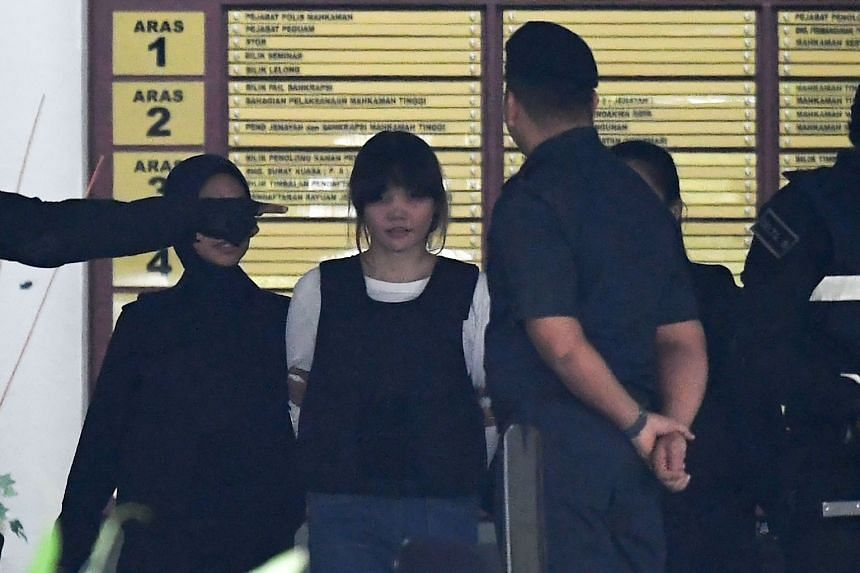 Vietnamese defendant Doan Thi Huong (second from left) being escorted by police after her trial at the Shah Alam High Court in Shah Alam, on Oct 2, 2017.