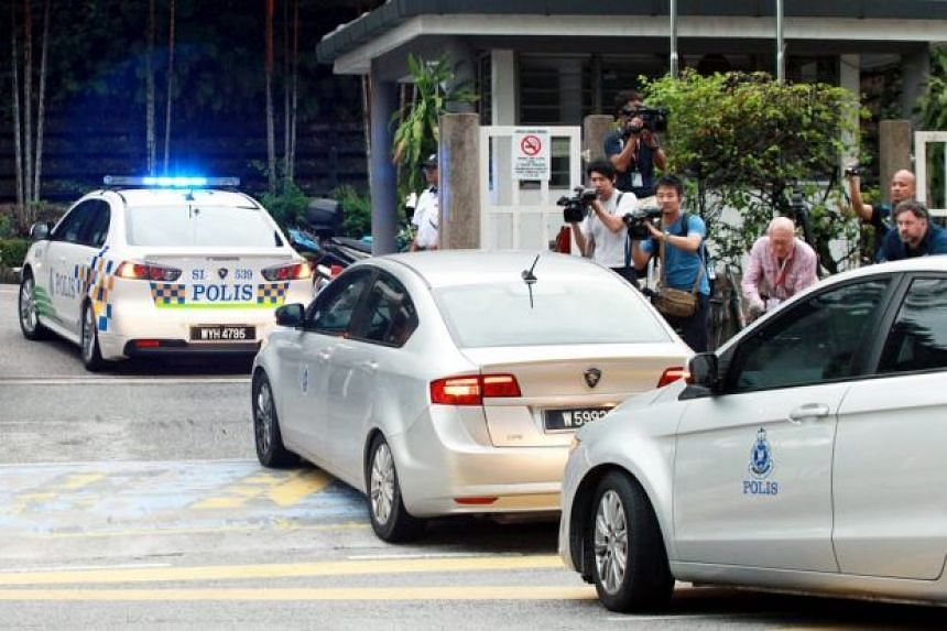 The car transporting Indonesian Siti Aisyah and Vietnamese Doan Thi Huong, escorted by four police vehicles, were seen arriving at the court compound at around 8am.