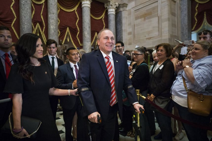 US House Majority Whip Steve Scalise (centre) walks through Statuary Hall on his first day back to Congress, on Sept 28, 2017.