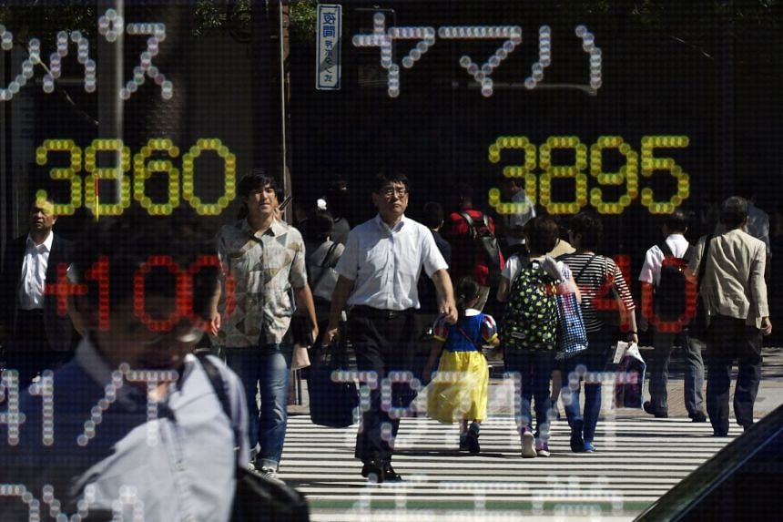 Asian shares were faring better than bonds after upbeat economic data from China, Japan and South Korea augured well for a sustained pickup in global growth.