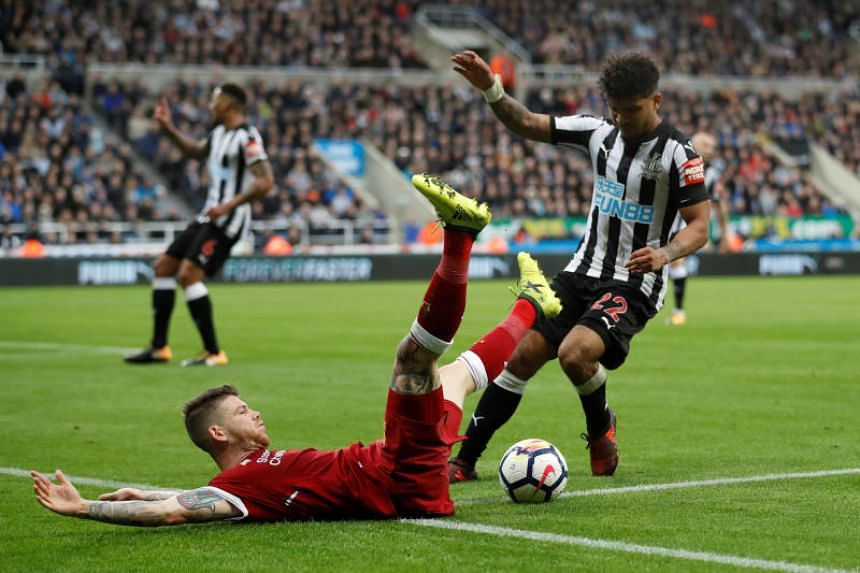 Liverpool's Alberto Moreno in action with Newcastle United's DeAndre Yedlin.