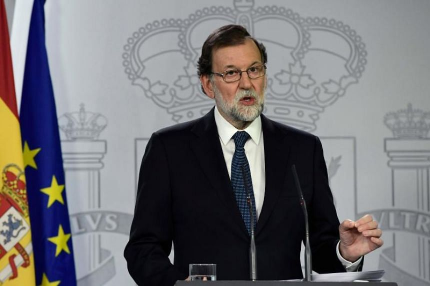 Spanish Prime Minister Mariano Rajoy speaks during a press conference at La Moncloa palace in Madrid on Oct 1, 2017.