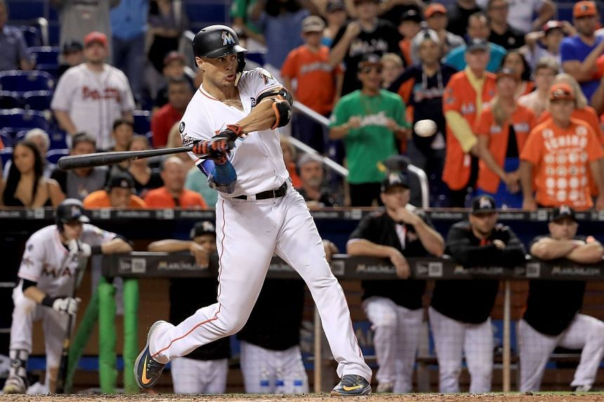 Giancarlo Stanton #27 of the Miami Marlins hits during a game against the Atlanta Braves at Marlins Park, on Oct 1, 2017.