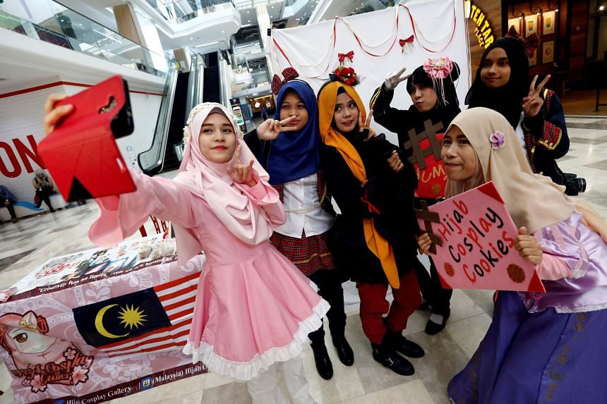 Muslim women cosplayers taking a wefie during an event at a mall in Petaling Jaya, near Kuala Lumpur, in July. Marketing trend and research outfit J. Walter Thompson's Innovation Group's report The New Muslimah: South-East Asia Focus shows more t