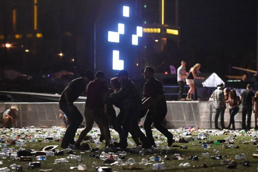 A victim is carried out after a gunman opened fire at the Route 91 Harvest country music festival on Oct 1, 2017.