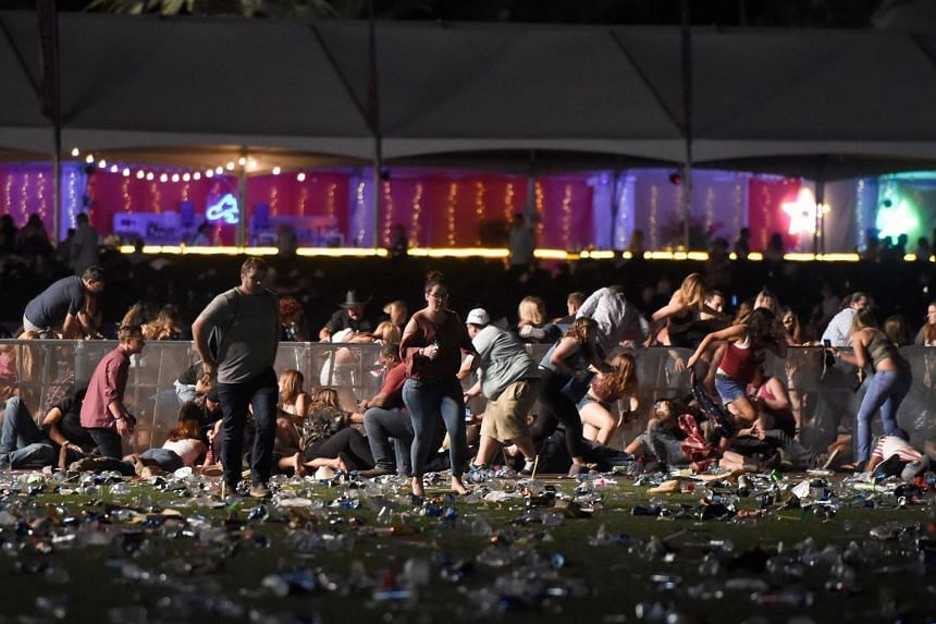 People running from the Route 91 Harvest country music festival after gunfire was heard, on Oct 1, 2017. Multiple people were reportedly taken to hospital.