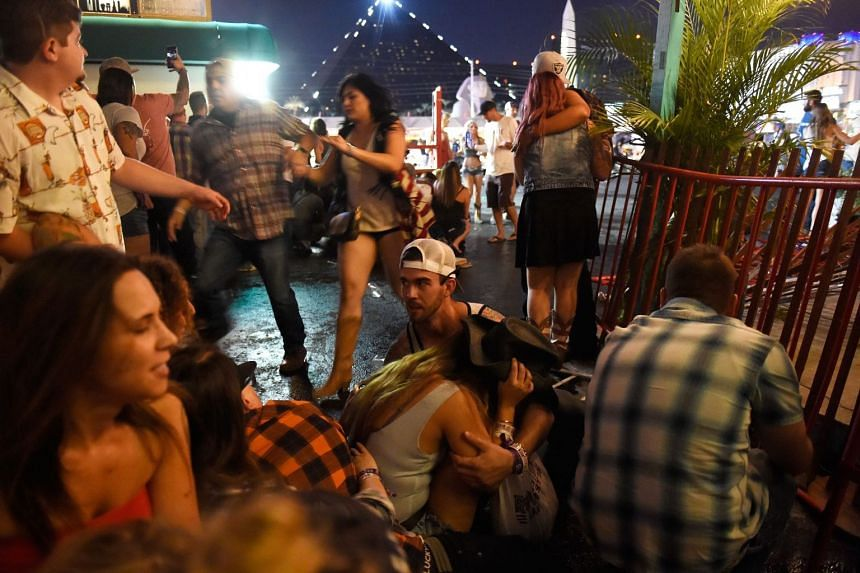 People seeking cover after a gunman opened fire at a music festival in Las Vegas, on Oct 1, 2017.