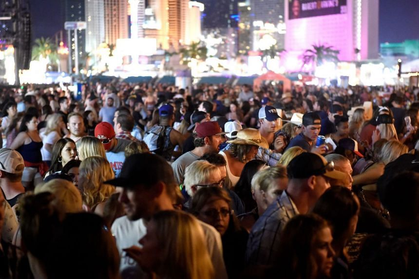 A crowd of people at the Route 91 Harvest country music festival after the shooting on Oct 1, 2017.