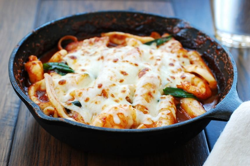 Spicy tteokbokki can be mixed with cheese to create a contrasting yet flavourful taste.