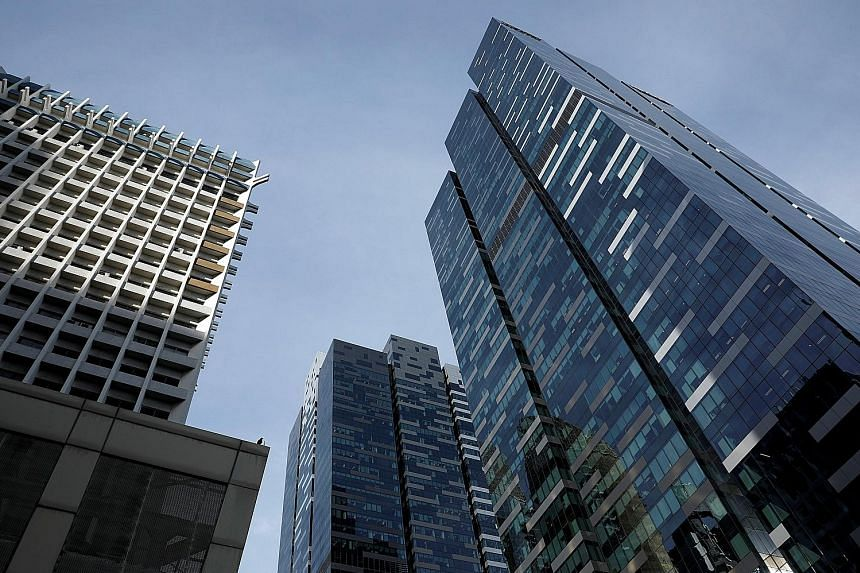 The $2.09 billion sale of Asia Square Tower 2 (far right), along with a bumper $1.622 billion bid for a Beach Road site last week, has sparked renewed interest in a commercial property market that is already bubbling away.