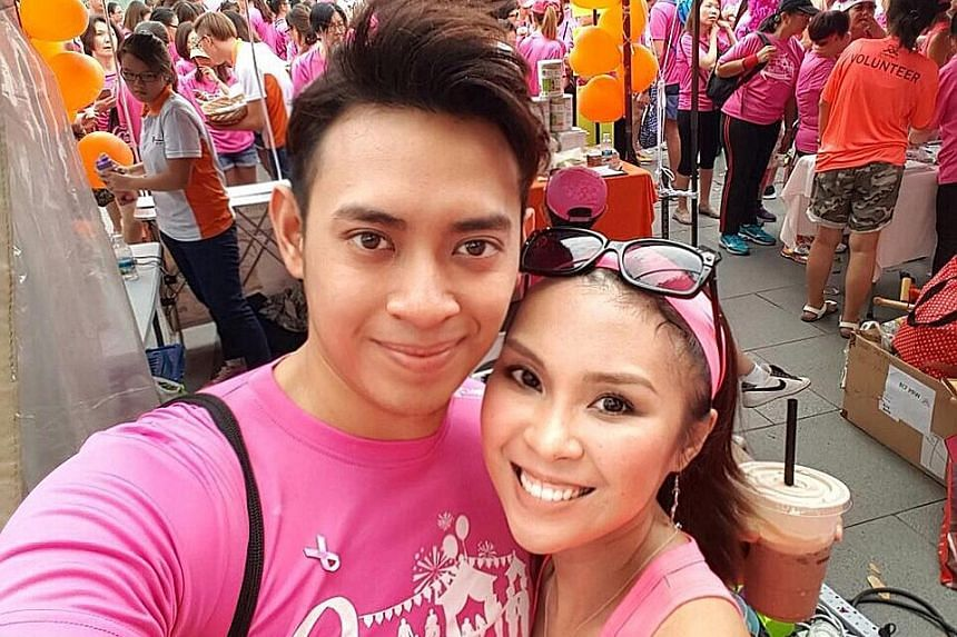Breast cancer survivor Branda Lai, 30, and her husband, Mr Zairil Azwar, 25, at last year's Pink Ribbon Walk.
