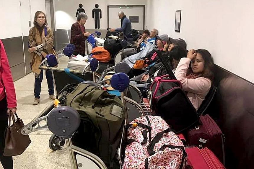 Some passengers had to spend a night at Sydney Airport due to the delay, which was caused by a defect in a circuit board.