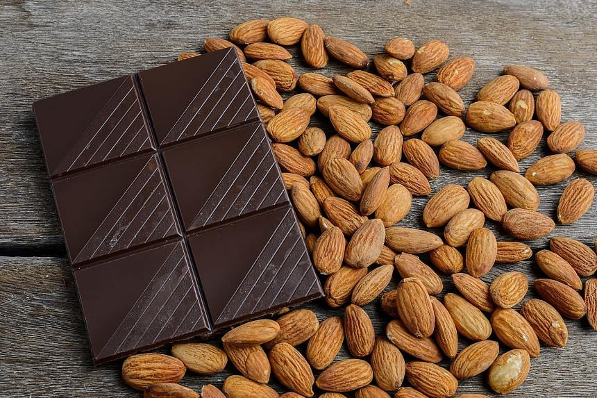 Dark chocolate contains flavanols, which may lower blood pressure and improve blood flow to the brain and heart. Almonds are also good for the heart.