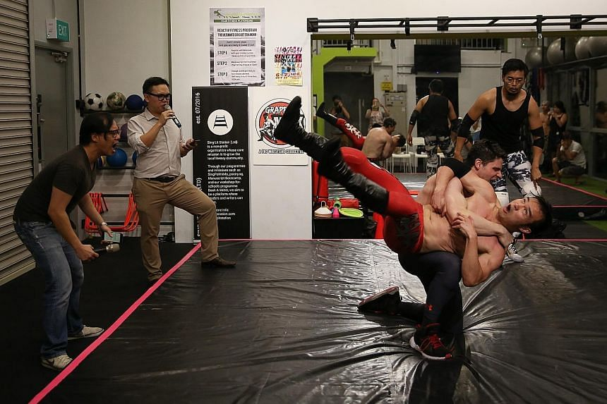 Poets (from far left) Joses Ho and Joshua Ip war verbally while wrestlers Greg Ho (in red tights) and Jeff Ederer fight in choreographed synchrony.