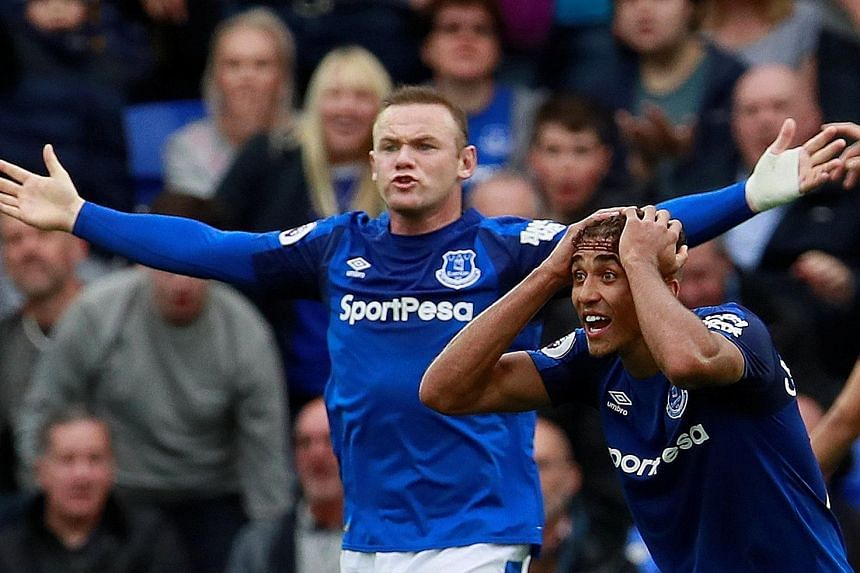 Everton's Wayne Rooney and Dominic Calvert-Lewin appealing in vain for a penalty during the home loss to Burnley. The Toffees are in 16th place, two points above the drop zone.