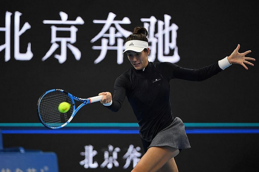 Wimbledon champion and world No. 1 Garbine Muguruza in action at the China Open before her first-round retirement owing to illness yesterday. She had suggested in the tournament build-up that she was not fully fit and promptly lost the first set 6-1
