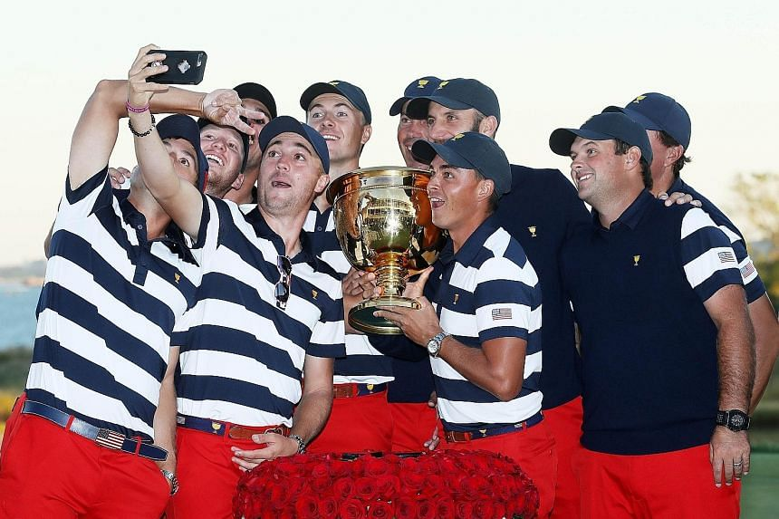 The US team celebrating with the Presidents Cup trophy after defeating the International team 19 to 11 at Liberty National Golf Club on Sunday. They have dominated the tournament since its 1994 inception, with 10 wins to just one for the Internationa