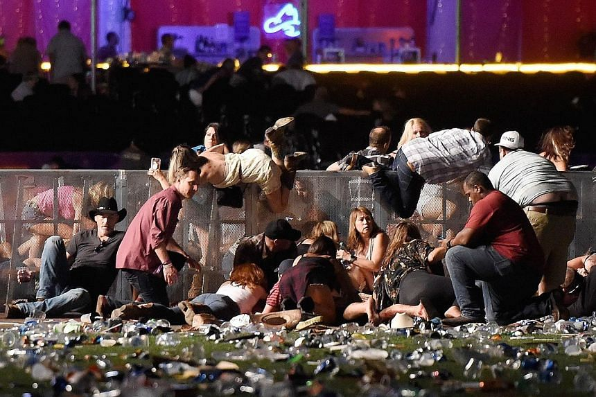 People scrambling for cover after gunfire broke out at the Route 91 Harvest music festival in Las Vegas on Sunday night. The gunman opened fire from the 32nd floor of a hotel. Police said the death toll may yet rise.