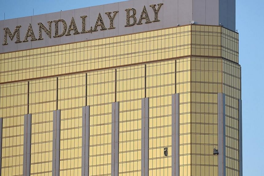 Left: The gunman opened fire from the 32nd floor of the Mandalay Bay Resort and Casino (in background) overlooking the Route 91 Harvest music festival grounds. Above: Broken windows on the hotel's 32nd floor following the shooting. Las Vegas shooter