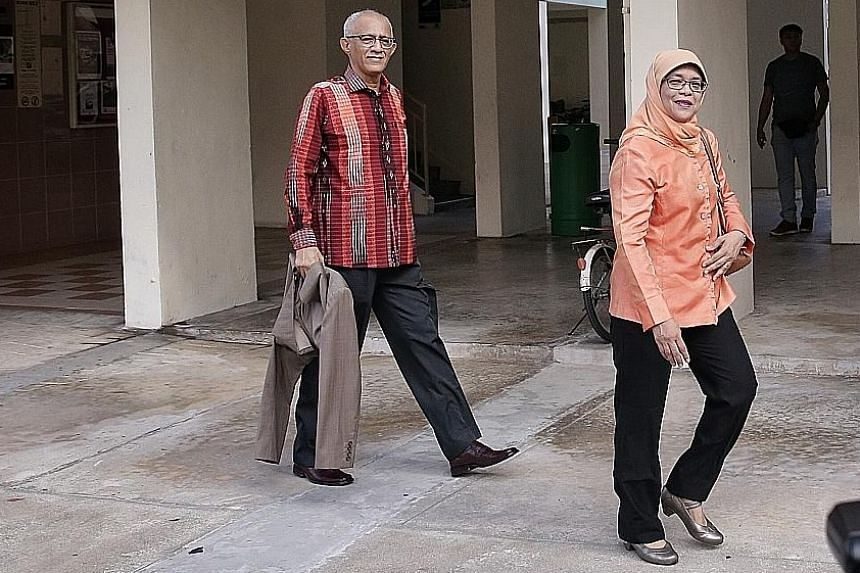 Above: An awning was put up at the foot of the HDB block where President Halimah Yacob lives. Left: Madam Halimah and her husband, Mr Mohamed Abdullah Alhabshee, leaving their Yishun flat on Sept 13.