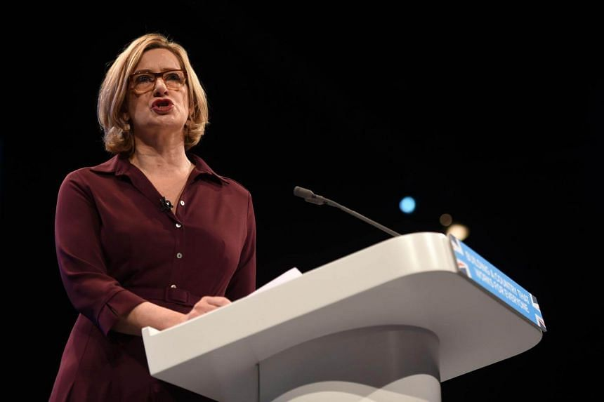 Britain's Home Secretary Amber Rudd delivers her speech on the third day of the Conservative Party annual conference at the Manchester Central Convention Centre in Manchester on Oct 3, 2017.