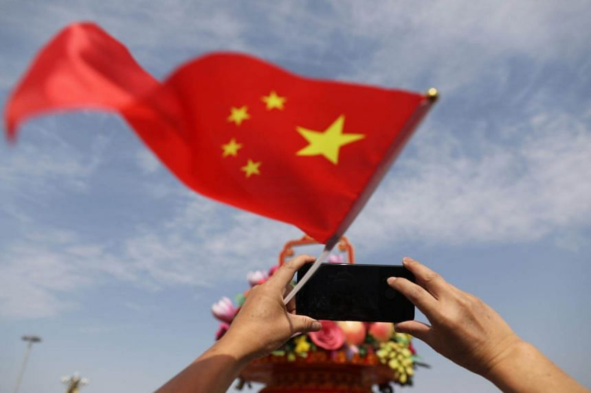 A Chinese tourist using their mobile phone to take a photograph in Tiananmen Square during National Day celebrations in Beijing, China on Oct 1 2017.