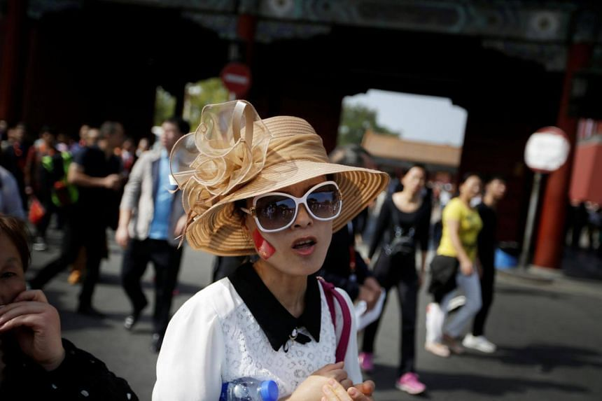 A tourist is pictured outside the Forbidden City in central Beijing, China on Oct 1, 2017.