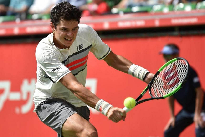 Canada's Milos Raonic returns a shot to Serbian Viktor Troicki during their men's singles at the Japan Open tennis tournament in Tokyo on Oct 3, 2017.