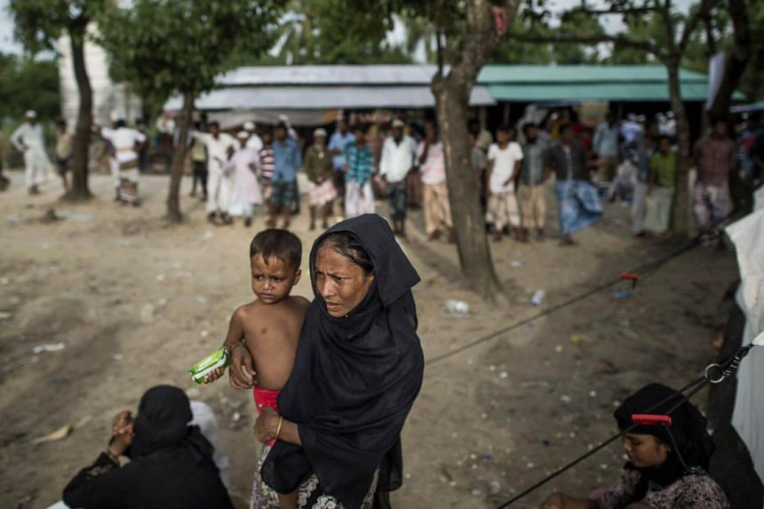 A Rohingya Muslim refugee at the registration centre after she crossed the border from Myanmar, in Teknaf, Bangladesh on Oct 2, 2017.