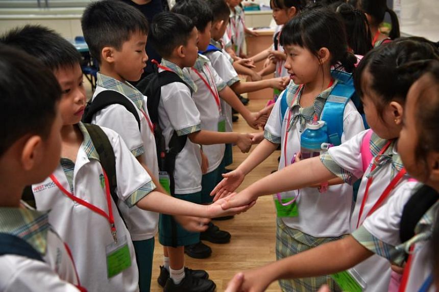 Westwood Primary 1 pupils introduce themselves during the first day of school on Jan 3, 2017.