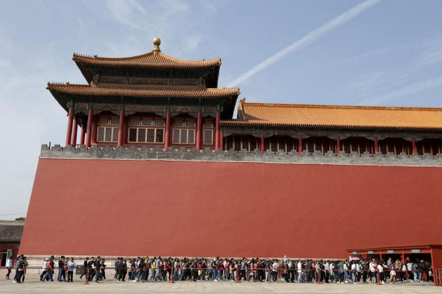 Tourists wait to visit the Forbidden City in central Beijing, China, on Oct 1, 2017.
