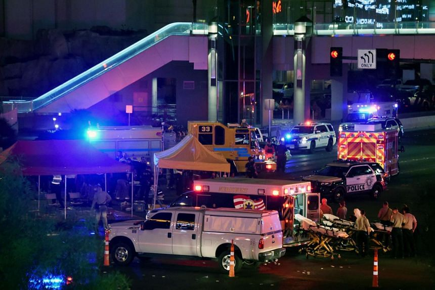 Police and rescue personnel gather at the intersection of Las Vegas Boulevard and Tropicana Ave. after a mass shooting at a country music festival nearby in Las Vegas, Nevada, on Oct 2, 2017.