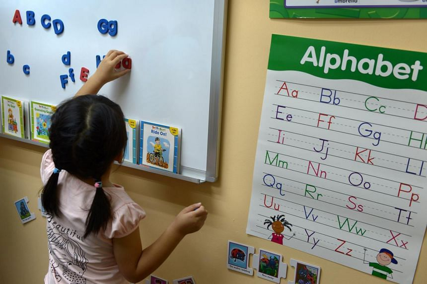 A child plays with magnetic letters at the 13th learning centre opened by the Dyslexia Association of Singapore at Teck Whye Lane in Choa Chu Kang on March 2014.