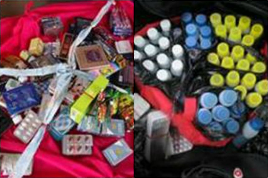 Of the 58 nabbed, seven men and a woman aged between 23 and 47 years old were arrested for various offences, including the peddling of illegal health products such as sexual enhancement drugs (left) and cough mixtures (right).