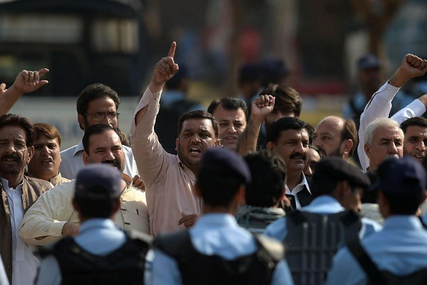 Supporters of former Pakistani prime minister Nawaz Sharif shout slogans outside an accountability court.