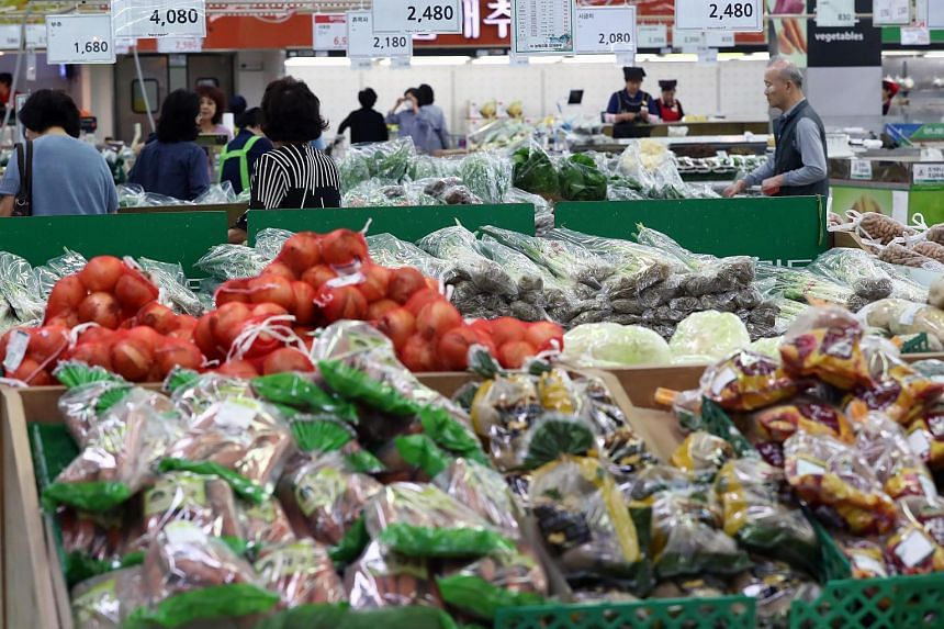 Customers shop at the fresh foods section of a giant supermarket in Seoul, South Korea, on Sept 20, 2017.