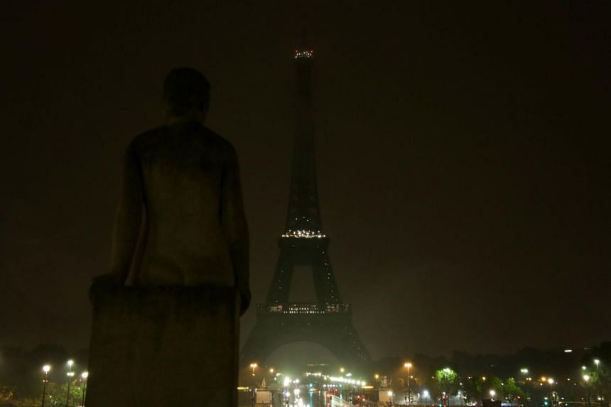 The lights of the Eiffel Tower in Paris are switched off on Oct 2, 2017 in tribute to the victims of the attacks in Las Vegas and Marseille.