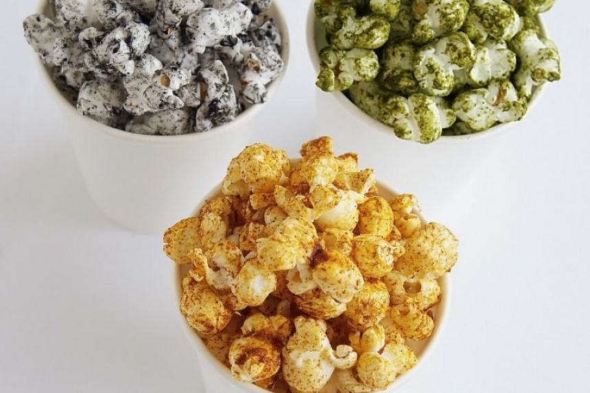 Popcorn can be considered healthy if air-popped. PHOTO: ST FILE