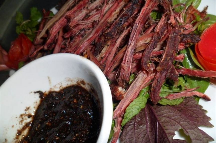 Many Vietnamese prefer to eat smoked buffalo meat with spicy lemon pepper salt and sipping cups of aromatic corn wine to wash down the delicacy.