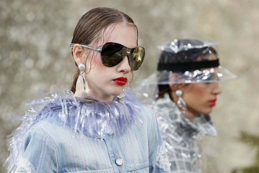 Models present creations for the Spring/Summer 2018 Ready to Wear collection by German designer Karl Lagerfeld for Chanel.