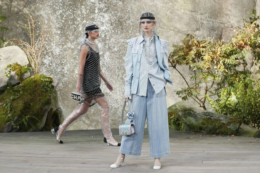Models present creations of the Spring/Summer 2018 Ready to Wear collection by German designer Karl Lagerfeld for Chanel.