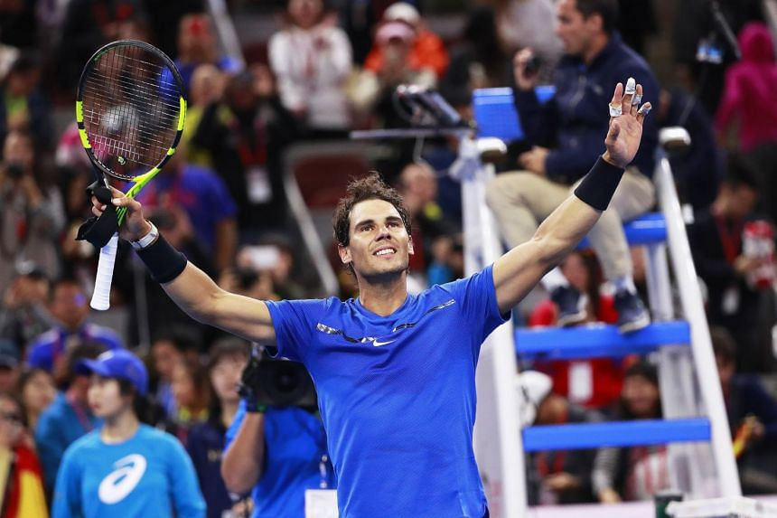 Nadal  celebrates his defeat of Lucas Pouille of France.