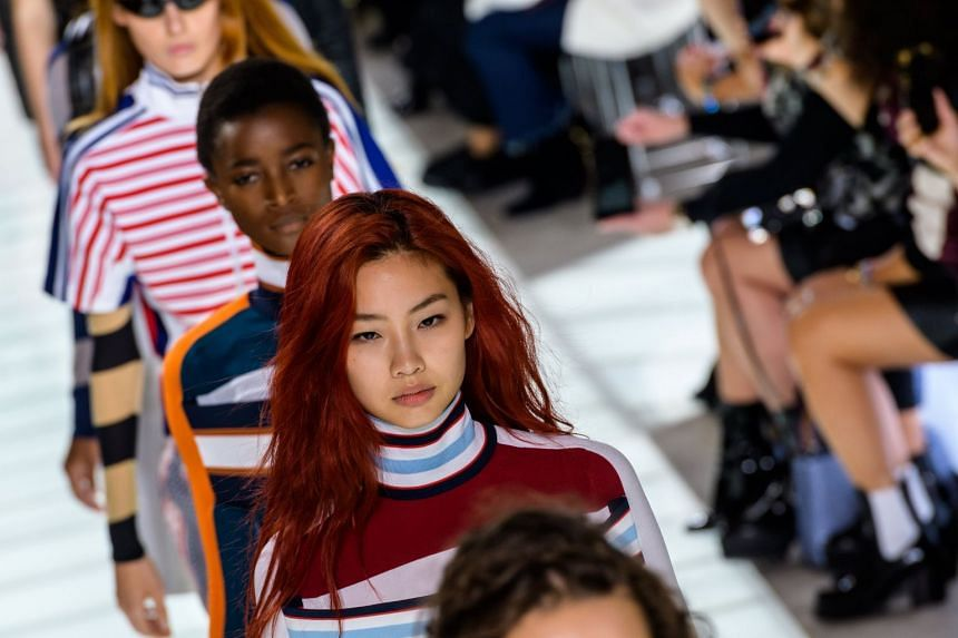 Models present creations of the Spring/Summer 2018 Ready to Wear collection by French designer Nicolas Ghesquiere for Louis Vuitton.