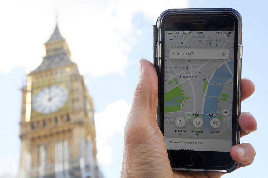 A photo illustration shows the Uber app on a mobile phone, with London's Big Ben in the background.