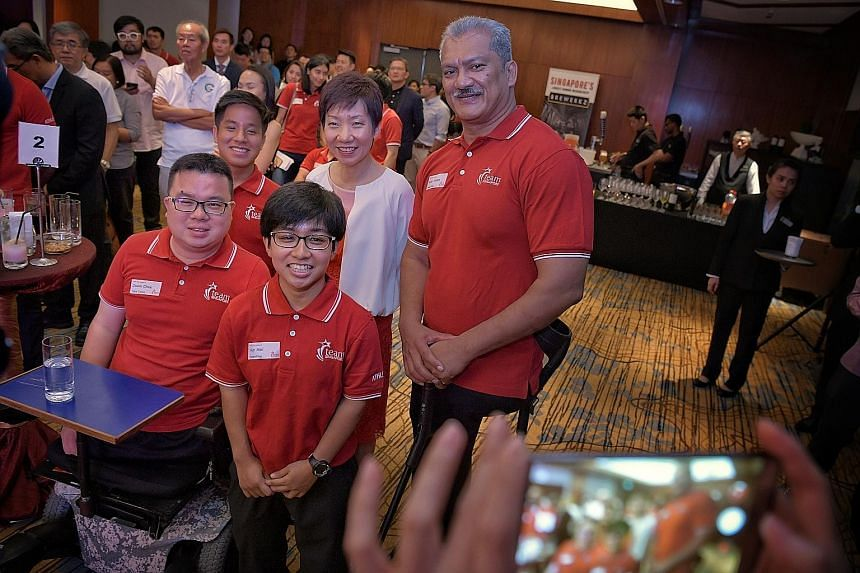 Minister for Culture, Community and Youth Grace Fu with (from left) national para athletes - paddler Jason Chee, footballer Jeremiah Tan and powerlifters Nur Aini Mohamad Yasli and Kalai Vanen. She urged Singaporeans to back the local sportsmen and w