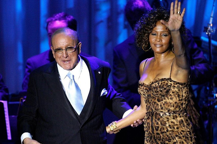 In this February 2009 photograph, singer Whitney Houston is seen with Clive Davis (both left) after her performance at the Industry Icons event.