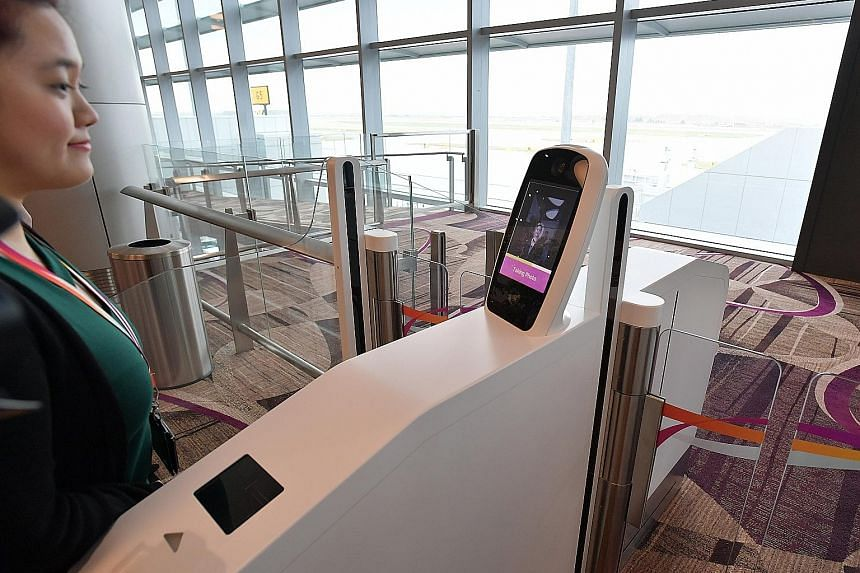 A dual facial and thumbprint biometric recognition system at Changi Airport's new Terminal 4. The Government is exploring the use of biometric technologies for identification and authentication, which are easy to use for the elderly, the young and th
