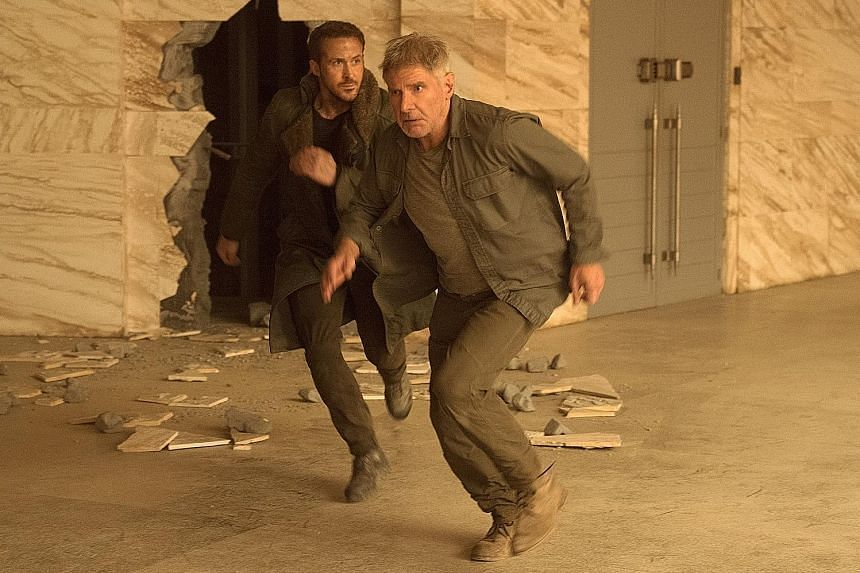 Blade Runner 2049, the sequel to the 1982 neo-noir fantasy about androids that look just like human beings, stars Ryan Gosling (far left) and Harrison Ford (left).
