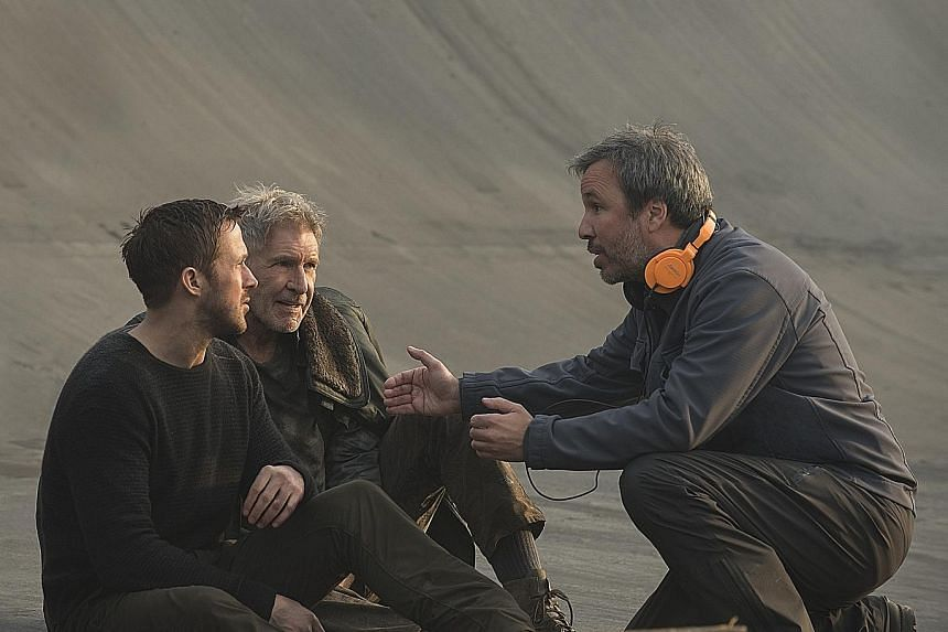 On the set of Blade Runner 2049 are (from far left) actors Ryan Gosling and Harrison Ford, and director Denis Villeneuve.